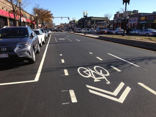 Shared-lane marking betwene dashed lines on Brighton Avenue