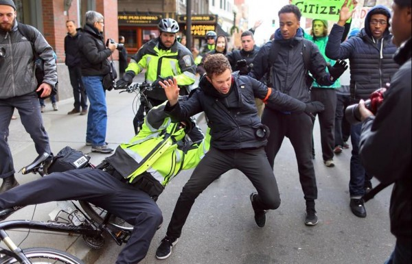 Police and protester scuffle on Tremont Street, December 14, 2014