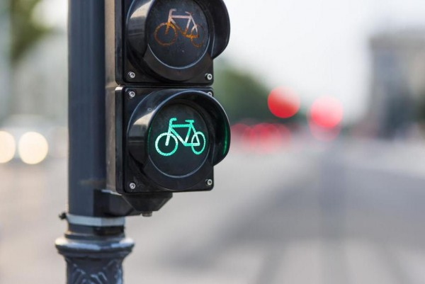 """Bicycle signals make crossing roadways safer for bicyclists by clarifying when to enter an intersection and by restricting conflicting vehicle movements."" Photo by Don Pablo for the Boston Globe."