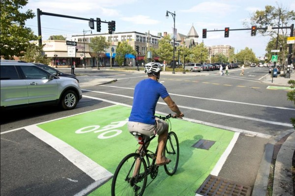 """A bike box is a designated area at the head of a traffic lane at an intersection that provides bicyclists with a safe and visible way to get ahead of queuing traffic during the red signal phase."" Photo by Dina Rudnick for the Boston Globe"